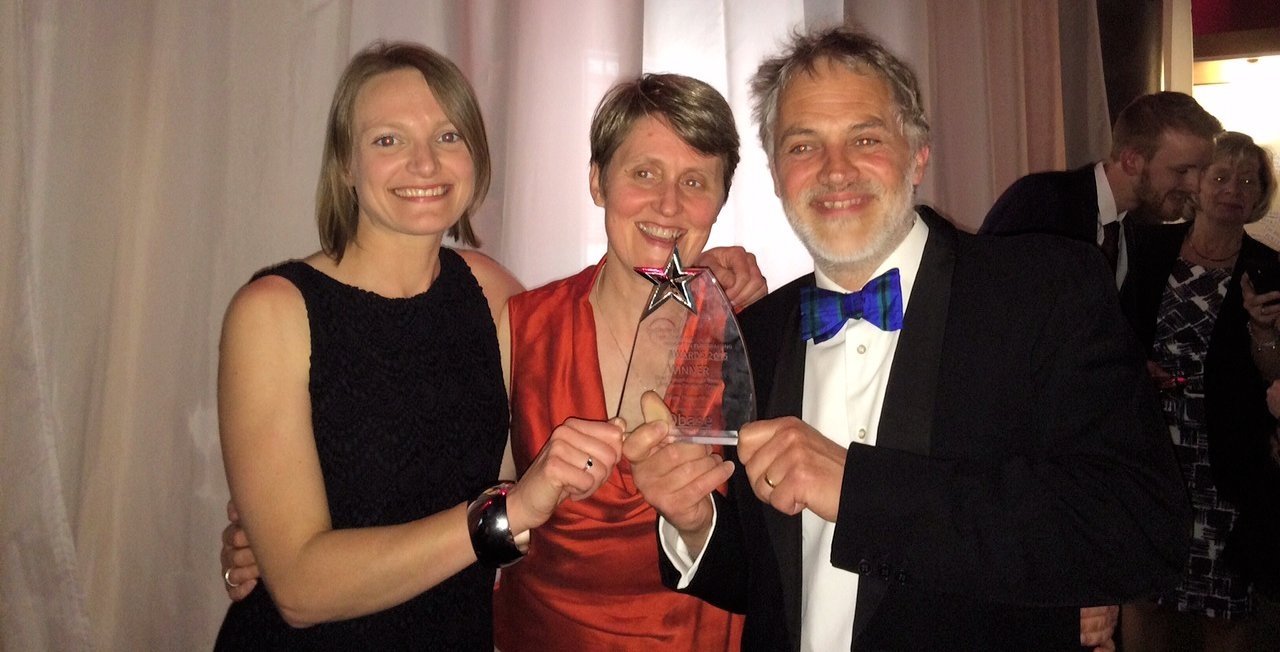 Rosie, Rebecca and Adrian with the Insight Award